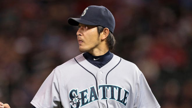 """Mariners pitcher Hisashi Iwakuma has a 7-3 record and 2.26 ERA after 16 starts this season. """"He has a great feel for the game, a great feel for situations,"""" manager Eric Wedge says."""