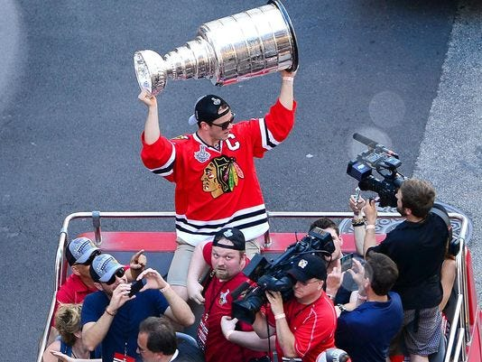 Chicago Blackhawks captain Jonathan Toews holds the Stanley Cup during ...