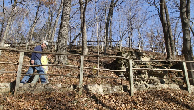 Paul and Sue Schramm, of Dyersville, hike  one of the trails at Effigy Mounds National Monument in Harpers Ferry.