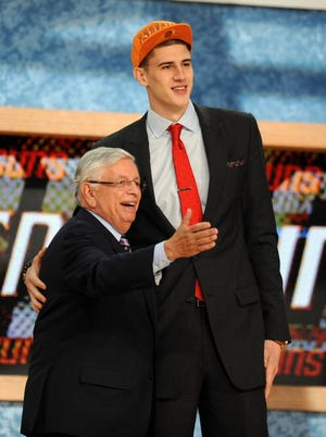 Suns center Alex Len was the fifth player to greet David Stern on the stage at the 2013 NBA draft.