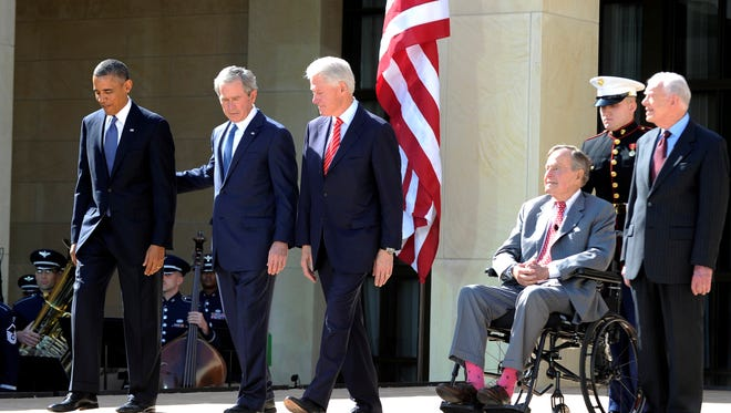 President BObama (L) and former Presidents (L-R) George W. Bush, Bill Clinton, George H.W. Bush and Jimmy Carter arrive on stage for the George W. Bush Presidential Center dedication ceremony in Dallas, Texas, on April 25, 2013.