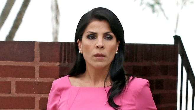 Jill Kelley is a Tampa socialite who is now suing the Justice and Defense departments.