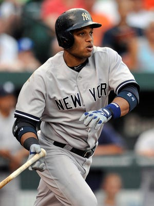 Robinson Cano had three of New York's 11 hits in the loss to Baltimore.
