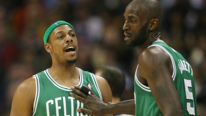 Paul Pierce, left, and Kevin Garnett have been offensive forces in Boston, but they may not be as much of a focal point in the Nets offense.