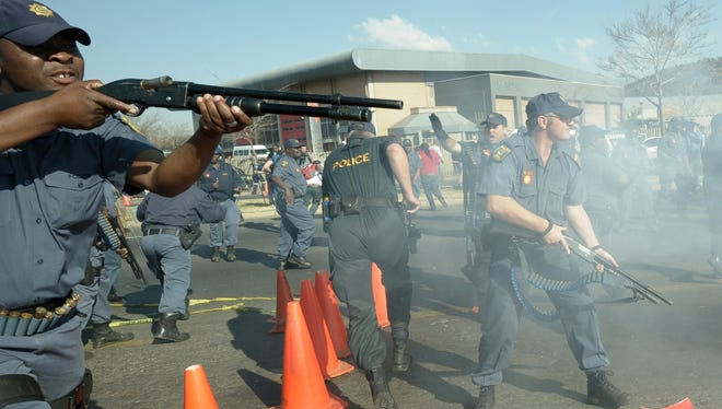 South African police fire rubber bullets at protesters rallying against President Obama's visit to South Africa, in Soweto on June 29, 2013.