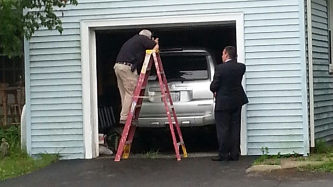 A silver Toyota 4-Runner was removed from a garage belonging to Aaron Hernandez's uncle, Andres Valderrama, Friday night.