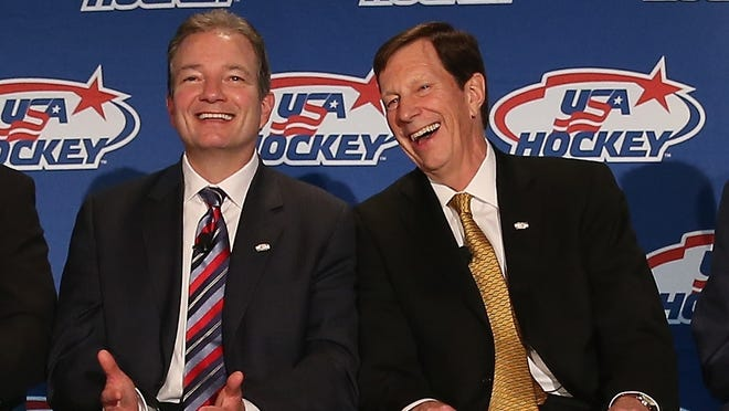 Team USA associate general manager Ray Shero, left, and general manager David Poile share as a laugh at Saturday's news conference.