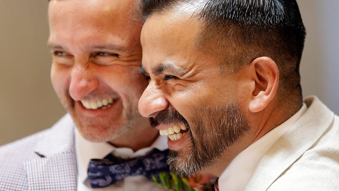 Peter Madril, left, and Monte Young embrace after getting married at City Hall in San Francisco, Saturday, June 29, 2013. Dozens of gay couples waited excitedly Saturday outside of San Francisco's City Hall as clerks resumed issuing same-sex marriage licenses, one day after a federal appeals court cleared the way for the state of California to immediately lift a 4 ½ year freeze. Big crowds were expected from across the state as long lines had already stretched down the lobby shortly after 9 a.m. City officials decided to hold weekend hours and let couples tie the knot as San Francisco is also celebrating its annual Pride weekend expected to draw as many as 1 million people. (AP Photo/Marcio Jose Sanchez) ORG XMIT: CAMS117