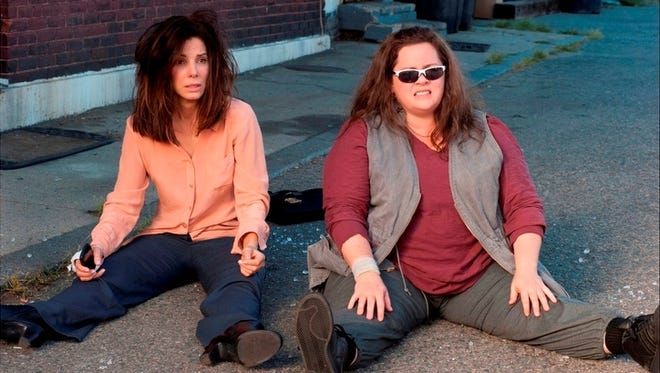 Sandra Bullock, left, and Melissa McCarthy brought 'The Heat' to the buddy-cop genre and landed in a surprising second place this weekend.