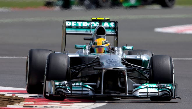 Mercedes driver Lewis Hamilton of Britain rounds Club Corner as he qualifies in pole position at Silverstone, England.