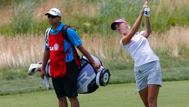 Jessica Korda of the USA on the fourth fairway with caddie Jason Gilroyed.