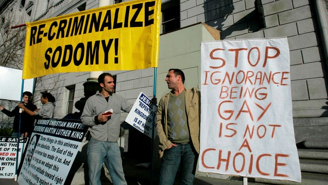 In this March 4, 2008 file photo, Luke Otterstad, left, and Kerry Coles argue pro and against views over the gay marriage debate outside of the California Supreme Court in San Francisco.