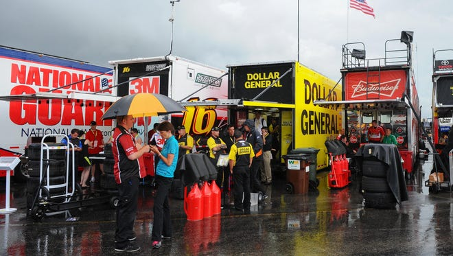Rain falls in the garage area before Saturday night's Quaker State 400 at Kentucky Speedway.