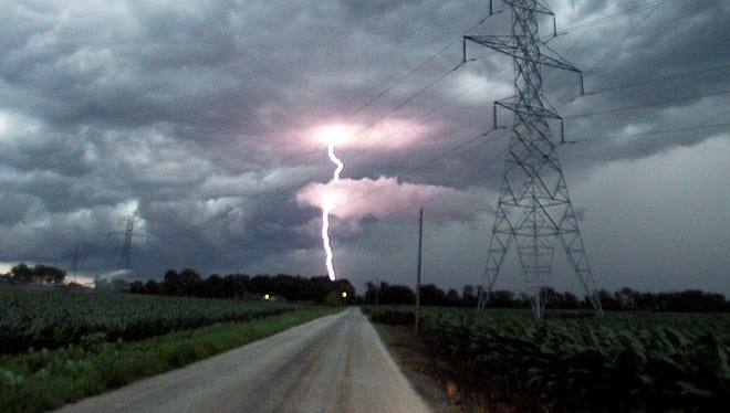Lightning emerges from a cloud as the leading edge of a severe storm passes over CR-300S east of U.S.