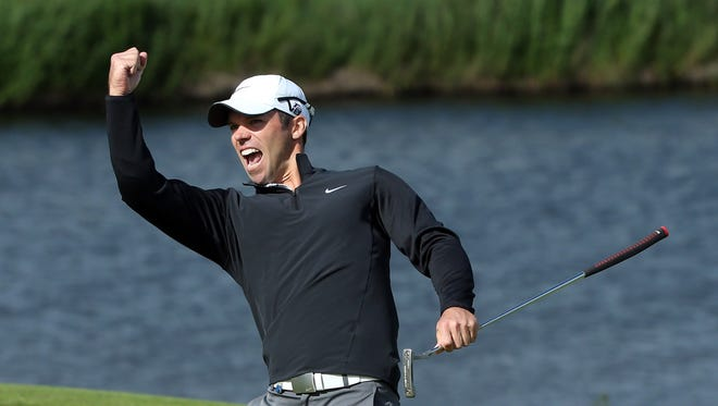 Paul Casey of England celebrates his eagle on the 18th green during the final round of the Irish Open at Carton House Golf Club on June 30, 2013 in Maynooth, Ireland.