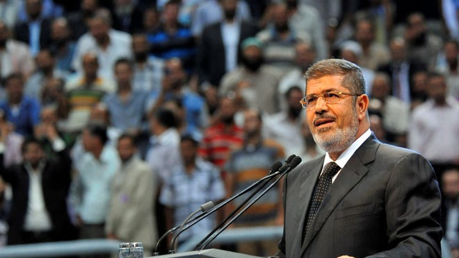 Egyptian President Mohammed Morsi addresses hard-line Islamists loyal to him last month in Cairo.
