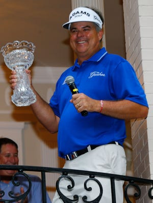 Kenny Perry hoists the trophy Sunday after winning the 2013 Constellation Senior Players Championship at Fox Chapel Golf Club.