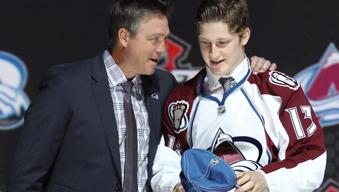 Nathan MacKinnon is congratulated by Colorado Avalanche president Josh Kroenke after being introduced as the No. 1 overall pick.