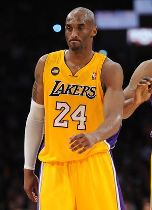 Lakers guard Kobe Bryant walks off the court April 12 vs. the Warriors with a torn Achilles tendon in his left foot.