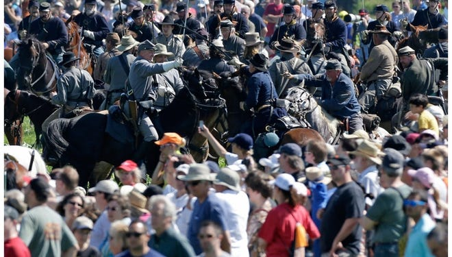 Re-enactors perform for spectators Saturday in Gettysburg, Pa., marking the battle's 150th anniversary.