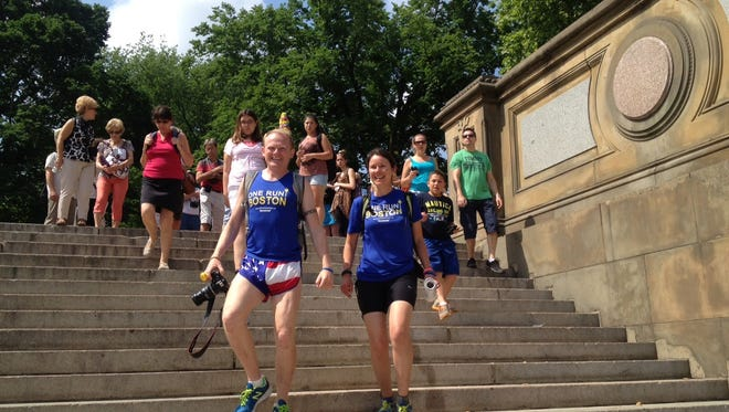 Organizers Danny Bent and Kate Treleaven arrive Saturday at One Run for Boston relay point at Bethesda Fountain in Central Park.