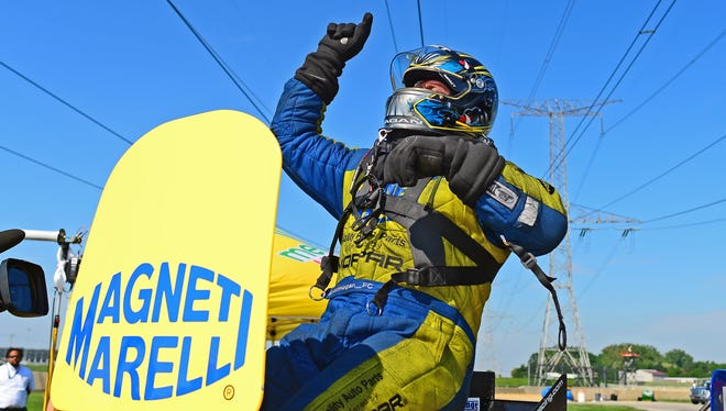 Matt Hagan celebrates after winning the Funny Car category Sunday at the Route 66 Nationals.