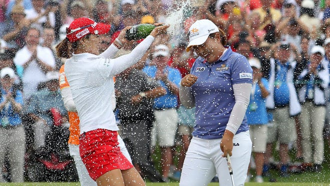 Inbee Park gets the champagne treatment from So Yeon Ryu and Na Yeon Choi.