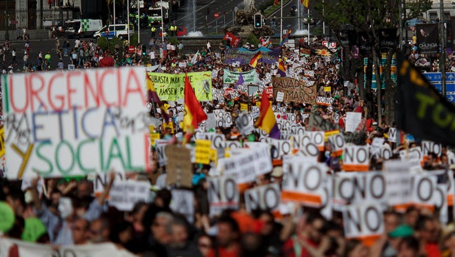 Protesters take part in a rally of Spain's Indignant movement at Cibeles Square. Rampant unemployment has been a major problem in Spain since the beginning of the global financial crisis.