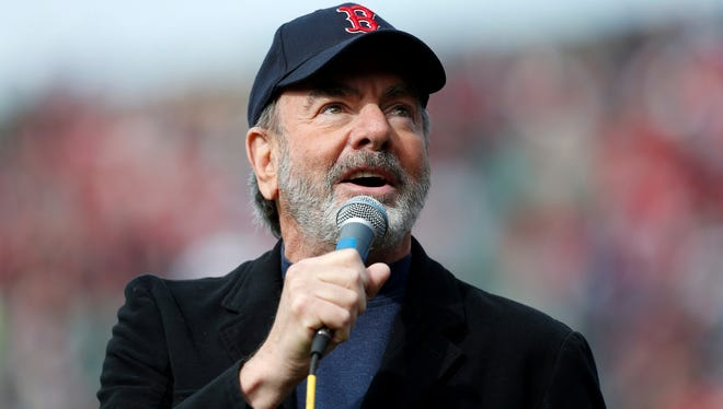 """Neil Diamond sings """"Sweet Caroline"""" at Boston's Fenway Park April 20 as the city sought to recover from the Boston Marathon tragedy."""