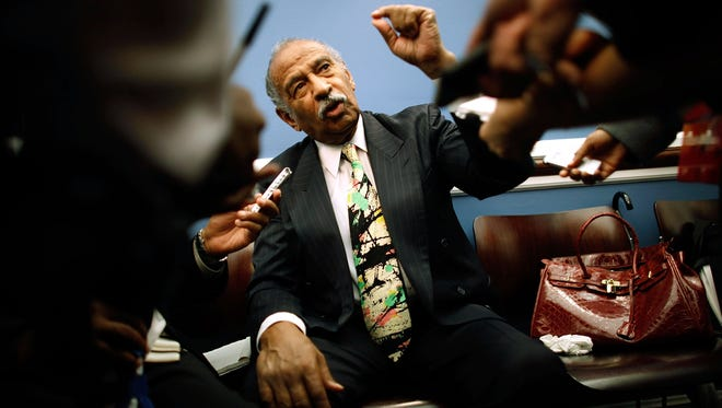 House Judiciary Committee Chairman John Conyers, D-Mich., talks with reporters after a press briefing with the Congressional Black Caucus, Sept. 9, 2009, in Washington, D.C.