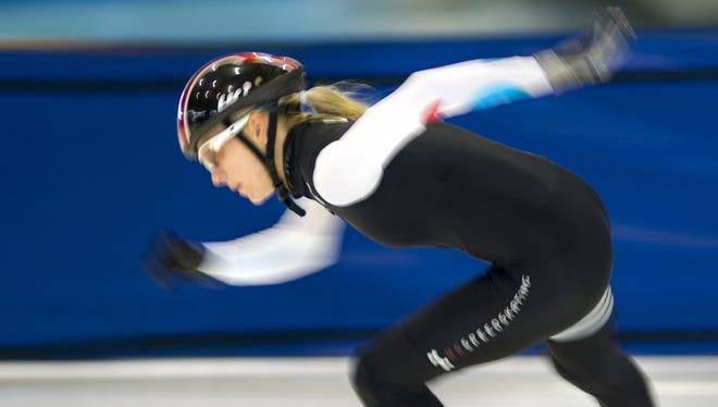 Short track speedskater Emily Scott trains at the Utah Olympic Oval in Kearns, Utah, on June 27. Scott hopes to make her Olympic debut in Sochi next February.