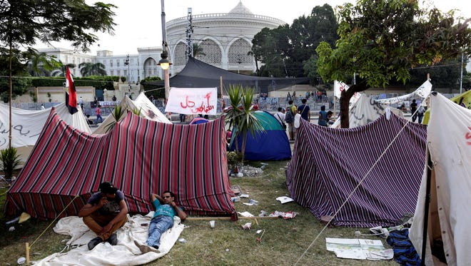 Opponents of Egypt's Islamist President Mohammed Morsi camp outside the presidential palace in Cairo on July 1, 2013.