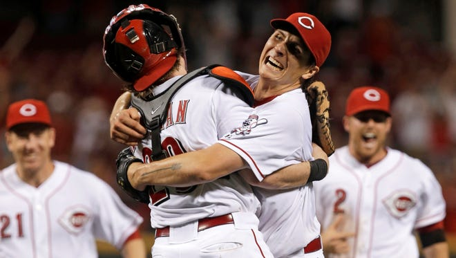 Cincinnati Reds starting pitcher Homer Bailey, right, hugs catcher Ryan Hanigan after Bailey threw a no-hitter against the San Francisco Giants.