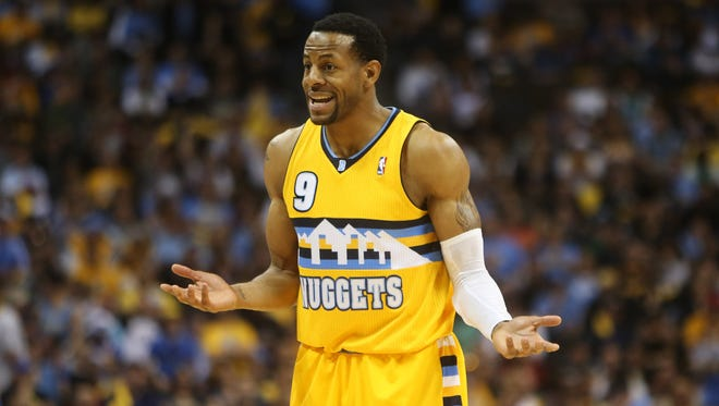 Denver Nuggets guard Andre Iguodala (9) reacts during the second half of game one of the first round of the 2013 NBA Playoffs against the Golden State Warriors at the Pepsi Center.
