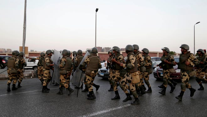 Military special forces surround supporters of Islamist leader Mohammed Morsi in Cairo's Nasser City on Wednesday.