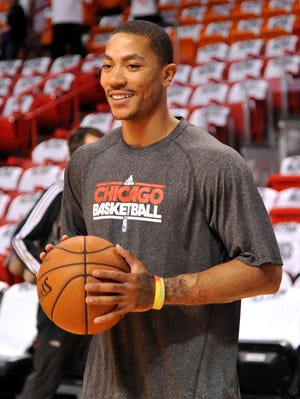 Derrick Rose often warmed up with the Bulls but didn't play last season.