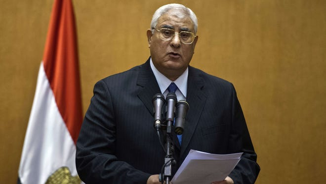 Egypt's chief justice Adly Mansour delivers a speech during his swearing-in ceremony as the country's interim president in the Supreme Constitutional Court in Cairo on Thursday.