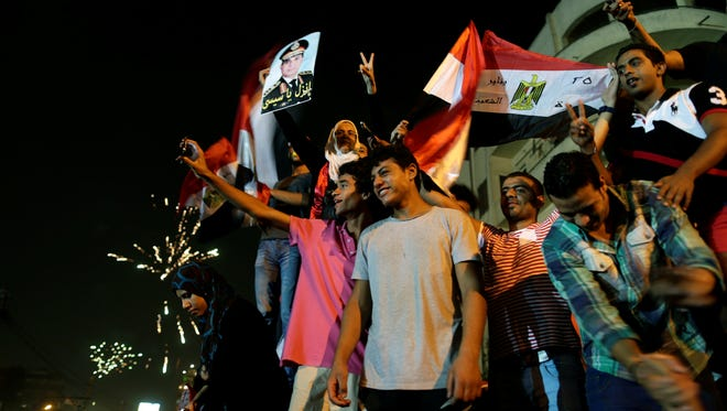 Opponents of ousted Egyptian leader Mohammed Morsi celebrate in Cairo on Wednesday.
