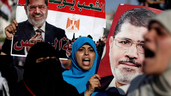 Supporters of Mohammed Morsi rally in Cairo Thursday.