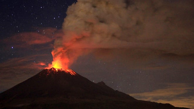Ash spew from Mexico's Popocatepetl volcano as seen from San Mateo Ozolco in the Mexican central state of Puebla, on July 4, 2013.