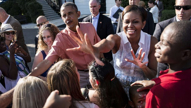 President Obama and first lady Michelle Obama greet military families at the White House.