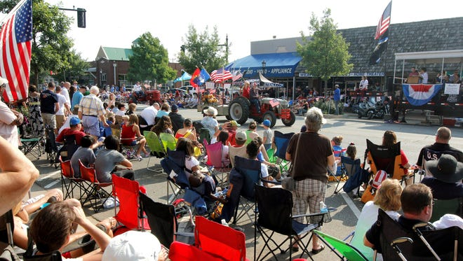 Spectators gather to watch the annual LibertyFest Fourth of July Parade in downtown Edmond, Okla, on Thursday.