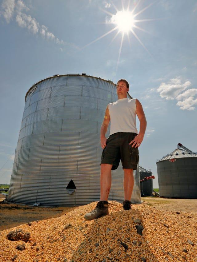 Farmer bucks odds, survives being trapped in grain bin