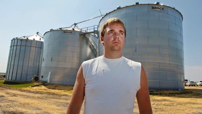 Arick Baker, 23, of New Providence, Iowa,  became stuck June 26 in an 80,000-bushel grain bin. He had gone into the bin to remove some rotten corn.