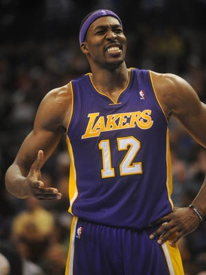 Los Angeles Lakers center Dwight Howard (12) reacts to a call against the Oklahoma City Thunder during the second half at Chesapeake Energy Arena.