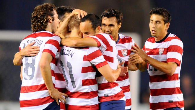 USA forward Landon Donovan (10) celebrates with teammates after a goal during the second half against Guatemala at Qualcomm Stadium.