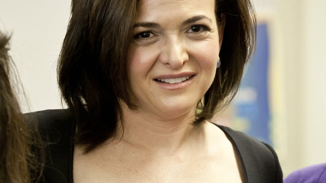 """""""Lean In"""" author and Facebook COO Sheryl Sandberg speaks to a group of young women students at Sequoia High School in Redwood City, Calif., on June 7."""