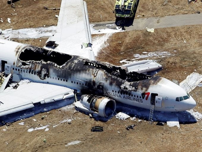 A Boeing 777 airplane lies burned on the runway after it crash landed at San Francisco International Airport July 6, 2013 in San Francisco.