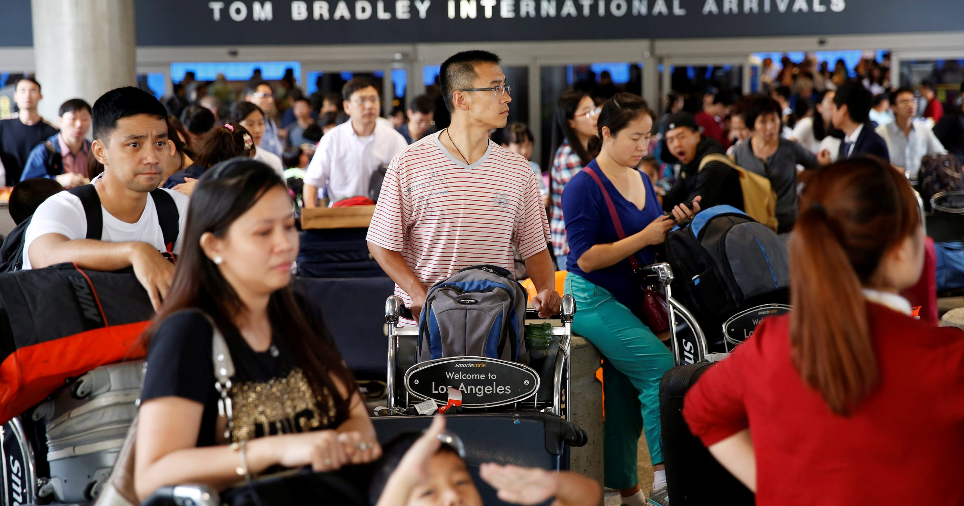 In China, relatives of Asiana passengers anxiously await news