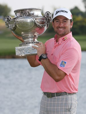 Graeme McDowell poses with his trophy after winning the French Open.
